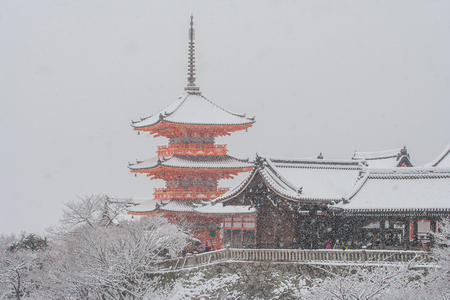 Beautiful winter seasonal image, Red Pagoda at Kiyomizu-dera temple covered white snow at Kyoto, Japan.