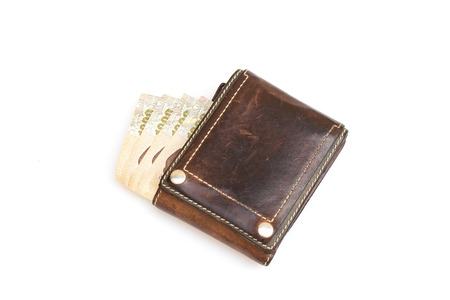 Top view of banknote in old brown leather wallet isolated on white background. (Selective focus) Stock Photo
