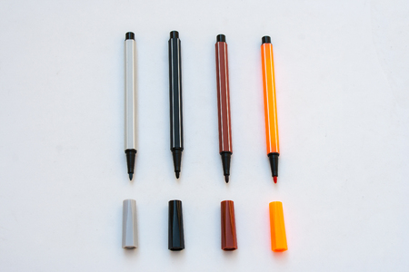 Colorful magic pens with cap isolated on white background. (Selective focus) Stock Photo