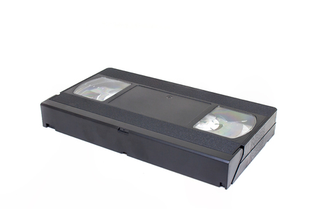 Old Video Home System or VHS tape cassette isolated on white background.