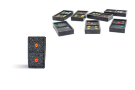 Business Leadership Concept : Close up old black dominoes pieces with colorful dot isolated on white background.