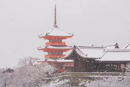 Beautiful landscape in winter seasonal : Red Japanese pagoda covered with white snow in Kiyomizu-dera Temple, Kyoto, Japan.