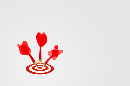 Marketing Concept : Three red darts hit target on dartboard. Archivio Fotografico