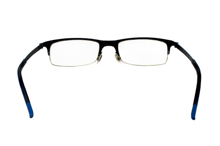 Old glasses or spectacles isolated on white background.