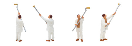 Miniature figurine character as painter standing and working in posture isolated on white background.