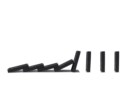 Business Dominoes Effect Concept : Row of dominoes falling isolated on white background.