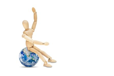 Business Globalization Concept : Wooden figure mannequin sitting on planet earth globe isolated on white background. 写真素材