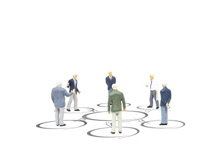 Business Teamwork Concept : Miniature figurine character as businessmen standing in the circle and discussing or talking together for brainstorming.