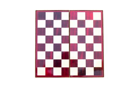 Top view of wooden portable chessboard isolated on white background.