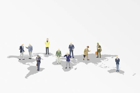 Business Teamwork and Global Concept : Group of business people standing on the world map.