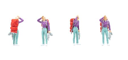 Miniature figurine character as passenger standing and posing in posture isolated on white background. Stock Photo