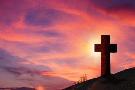 Silhouette wooden cross on hill with beautiful landscape in background. Reklamní fotografie