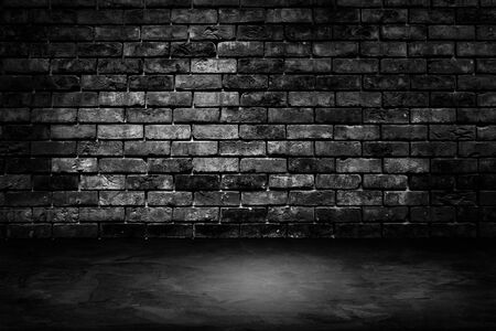 Abstract image of Architecture dark room black brick wall with concrete floor.