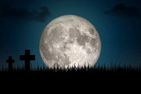 Halloween Concept : Many silhouette wooden cross on hill at tomb with full moon in dark night. (Elements of this image furnished by NASA.) Imagens