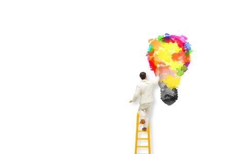 Business Idea Concept : Miniature people as painter painting  light bulb isolated on white background.