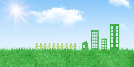 Ecology and Environmental Concept : People or Human icons holding hands together with green building and blue sky in background. Stock Photo