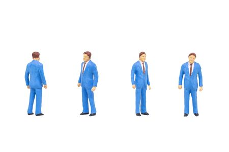 Miniature figure character as passer people posing in posture isolated on white background. Stock Photo