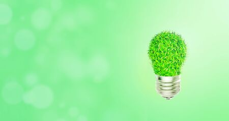 Ecology and Environmental Concept : Green light bulb with bokeh light in background.