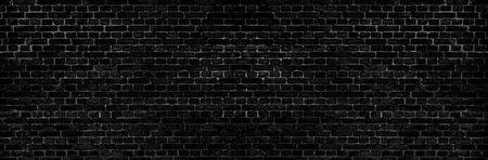 Abstract image of Rustic black grunge brick wall texture background for interior decoration.