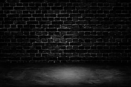 Abstract image of Architecture dark room black brick wall with concrete floor. Stock Photo