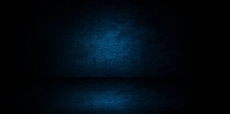 Abstract image of Studio dark blue room gradient background for interior decoration.