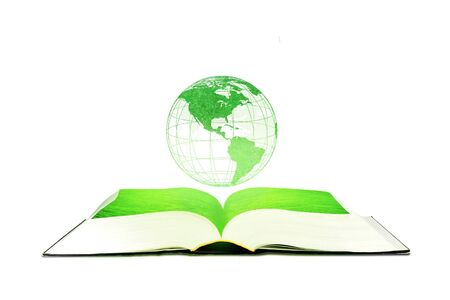 Ecology and Education Concept : Green planet earth globe floating over opened book isolated on white background. Stock Photo