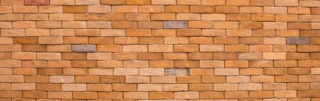 Abstract panorama image of Orange grunge brick wall texture background. Stock Photo