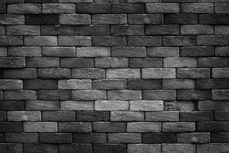 Abstract image of Rustic black grunge brick wall texture background.