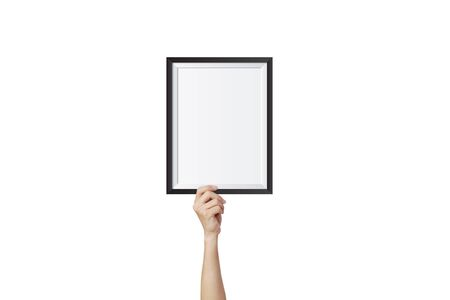 Hand holding and showing empty blank photo frame isolated on white background.