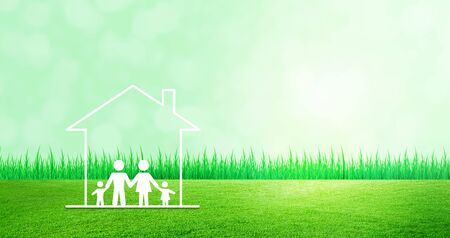 Happy Family Concept : Family and home icons on green grass meadow field with green natural and sunlight in background.