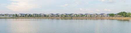 Panorama tropical view of New home or residential building under construction locate nearly lake with blue sky and sunlight in the evening time.