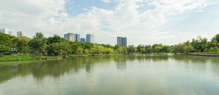 Beautiful panorama view of City public park with lake and green trees in background. Stock Photo