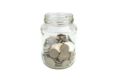 Business Money Savings Concept : Silver coins fill half of glass jar isolated on white background. Stock Photo