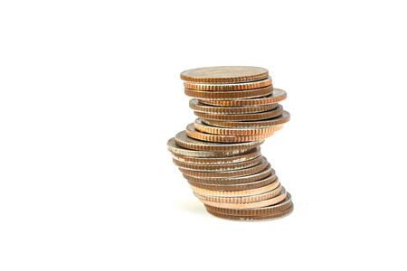Close up stack or pile old silver coins isolated on white background.