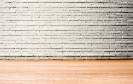 Empty space studio room of white brick wall and wooden floor. Stock fotó