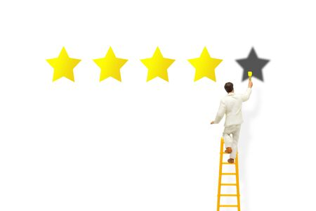 Customer Feedback Concept : Painter standing on ladder and painting yellow stars on white background for best service ranking.