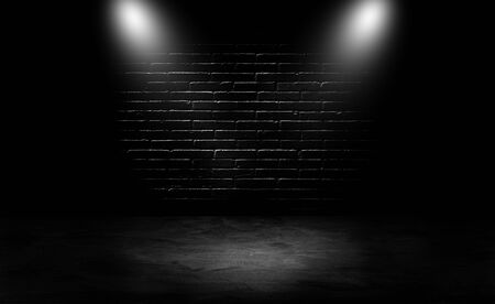 Studio empty dark room black brick wall and spotlight use for product showing and advertising.