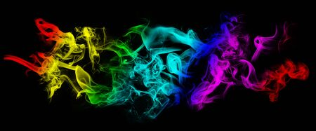Abstract image of Colorful smoke or fog in black background. Фото со стока