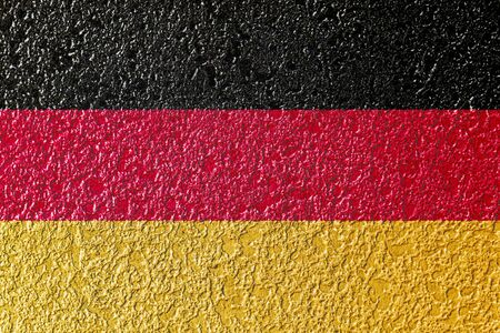 Abstract image of Germany flag on rough colorful cement plaster wall texture background.