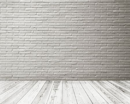 Empty space of Studio room of white brick wall and wooden floor.