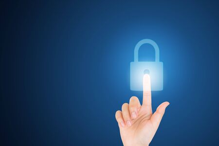 Technology, Internet, Digital and Networking Security Concept : Finger hand touching and pressing virtual lock icon symbol.