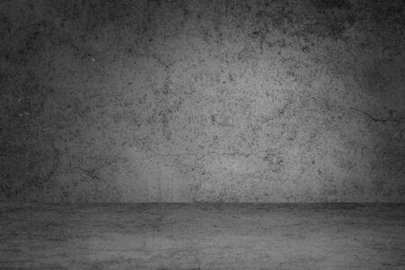 Empty space of Studio dark room black concrete grunge wall with concrete floor.