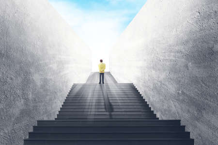 Business Vision and Success Concept : Businessman standing on concrete staircase and looking forward to sky.