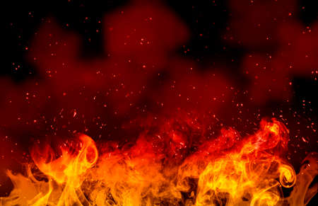 Abstract image of Orange fire or flames with sparkles in black background.