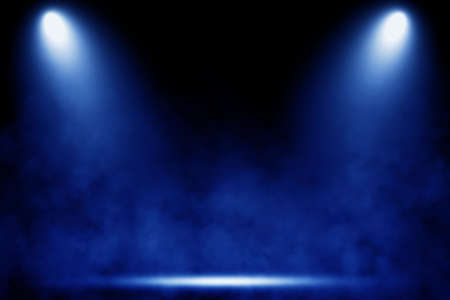 Empty space of Studio dark room with blue lighting effect and smoke in black background.
