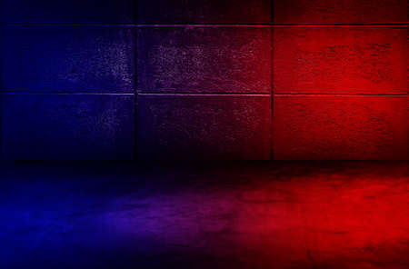 Abstract image of Studio dark room with lighting effect red and blue on concrete wall grunge texture background. 版權商用圖片