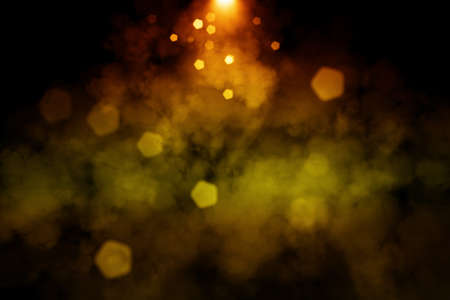 Abstract image of Smoke or fog with golden lighting effect in black background.