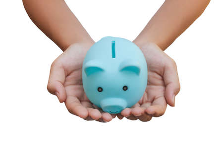 Money Savings Concept : Female hand hold blue piggy bank isolated on white background. (Clipping path)