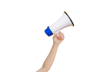 Female hand holding megaphone for announcement and advertisement. (Clipping path) 版權商用圖片