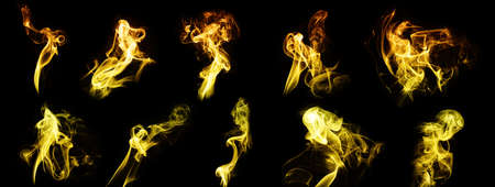 Abstract image of Golden smoke or fog in black background. 版權商用圖片
